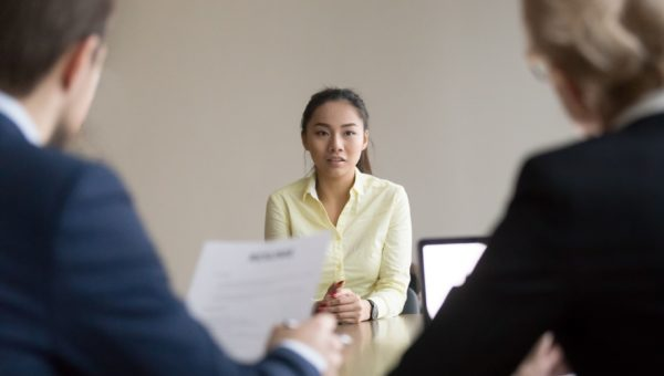 employee sits in front of potential employer
